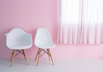 White chairs over pink wall