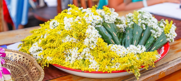 White chamomile flowers and yellow acacia flowers bouquet