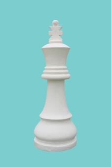 White chess king standing isolated on cyan background