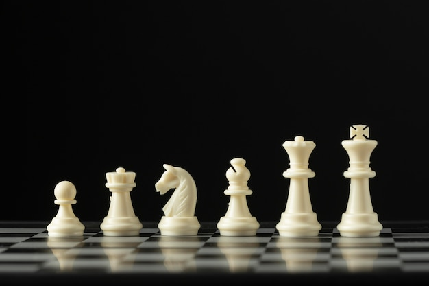 White chess pieces on chess board