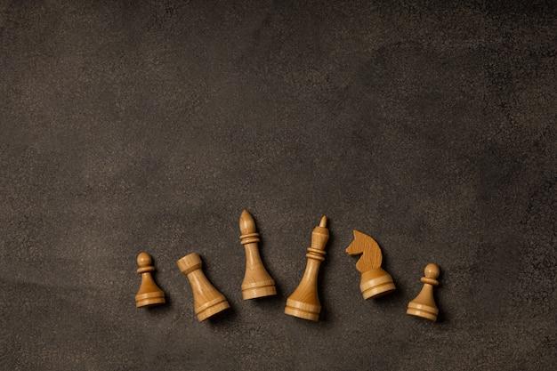 White chess pieces on dark background