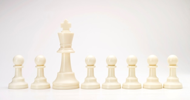 White chess pieces on gray background