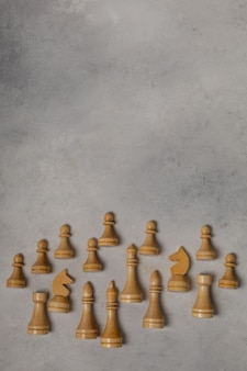 White chess pieces on a light background