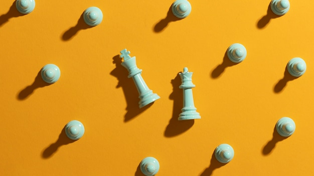 White chess pieces on yellow background