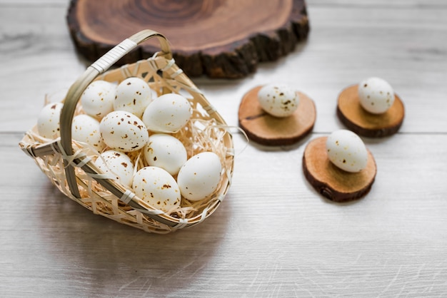 White chicken eggs in basket on table