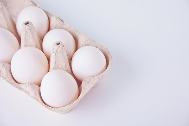White chicken eggs in egg box. copy space.