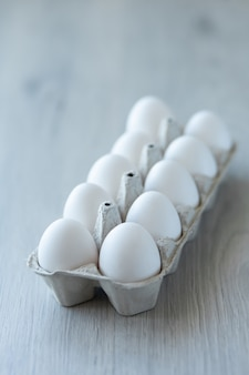 White chicken eggs in an open eco-friendly cardboard box
