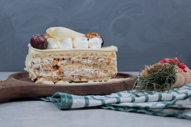 White chocolate cake on wooden board with christmas decorations. high quality photo