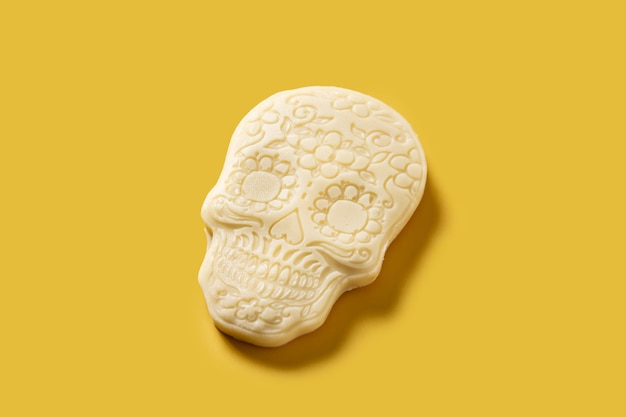 White chocolate mexican skull on yellow background