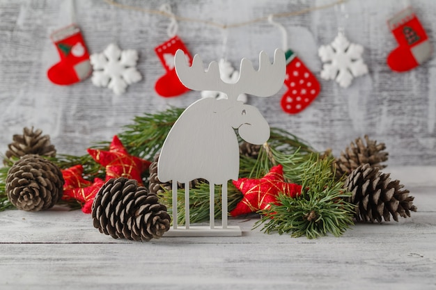 White christmas ornaments, xmas tree on rustic wood table. merry christmas card. winter holiday theme. happy new year.