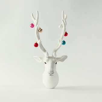 White christmas reindeer head with antlers with christmas baubles