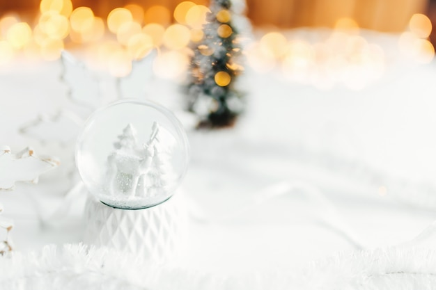 White christmas snow globe on a table with christmas decorations. high quality photo