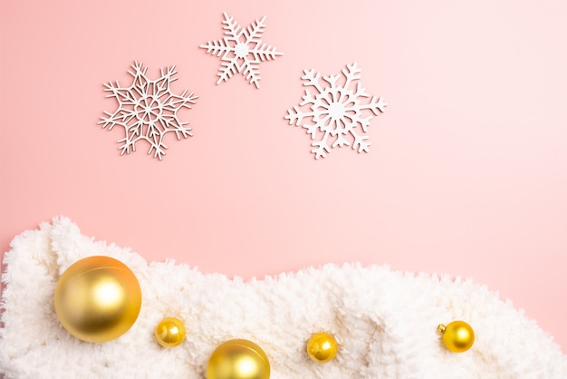 White christmas snowflakes decoration on pink background. christmas wallpaper.