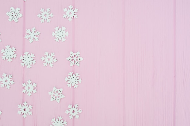 White christmas snowflakes decoration on pink wooden