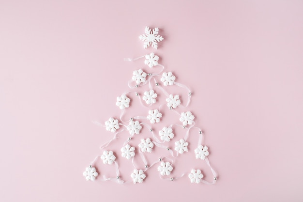 White christmas tree decoration on pink background. christmas wallpaper.