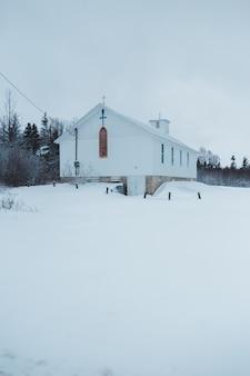 White church in snow in winter