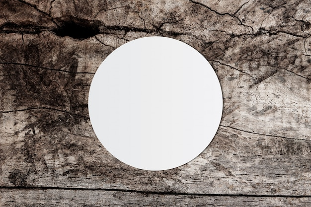 White circle paper and space for text on old wooden background