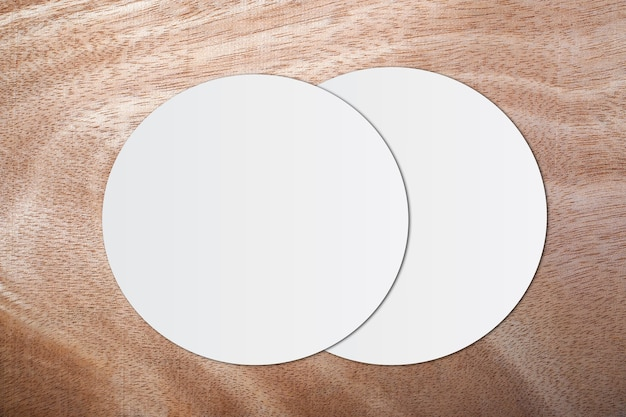 White circle paper and space for text on wooden background