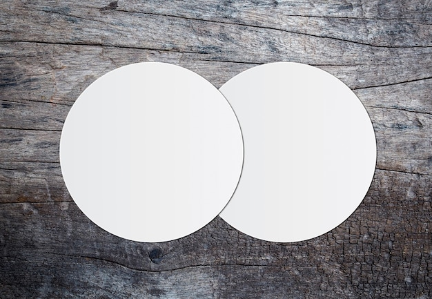 White circle paper and space for text on wooden crack background