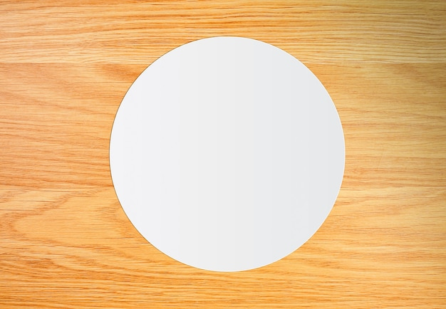 White circle paper on vintage brown wooden board
