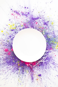 White circle on pink, violet and yellow bright dry colors