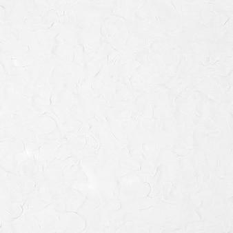 Fondo strutturato dell'argilla bianca nello stile minimo di arte creativa astratta di diy