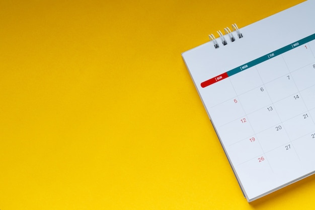 White clean calendar on  yellow background with copy space