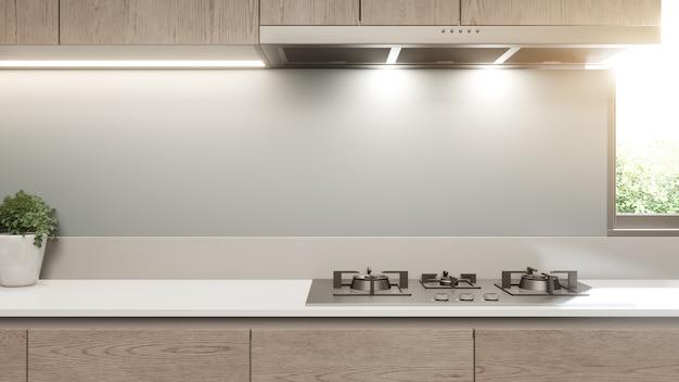 白いきれいなカウンターと豪華な家のモダンなキッチンの木製キャビネット。