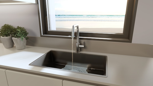 White clean counter and cabinet of modern sea view kitchen in beach house.
