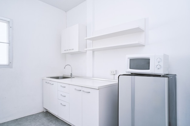 White clean kitchen room with built-in furniture decoration