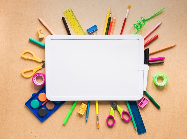 White clipboard and bright stationary on table