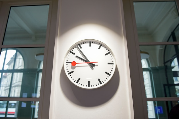 White clock in wall background