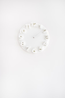 White clock on white wall