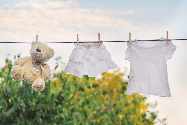 White clothes dry on a rope in the summer.