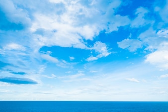 White cloud on blue sky with sea and ocean