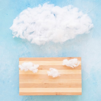 White cloud on wooden table