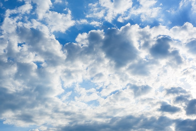 White clouds against the blue sky, blue sky with clouds background.