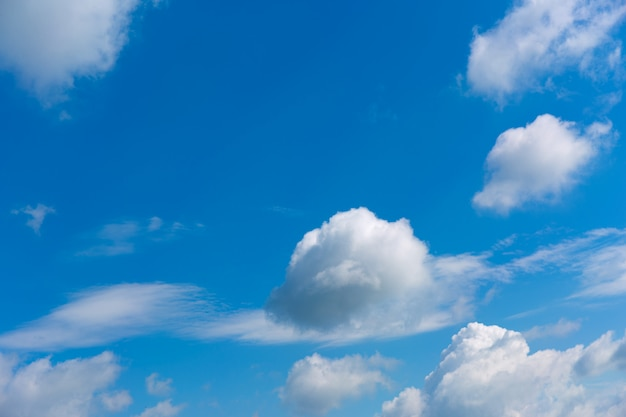 White clouds on blue sky .