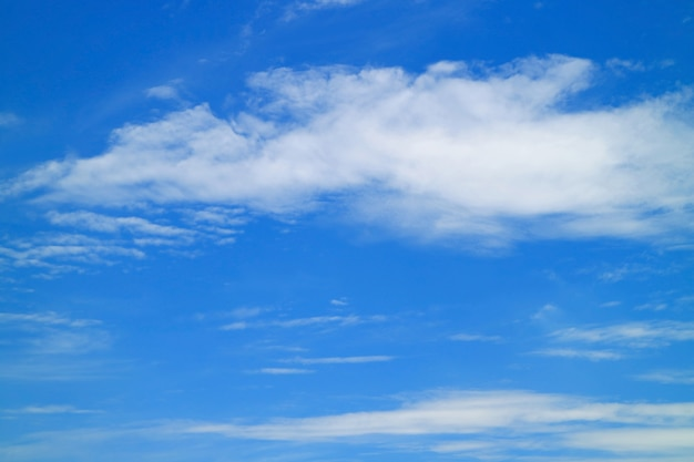 White clouds spread across the vibrant blue sky