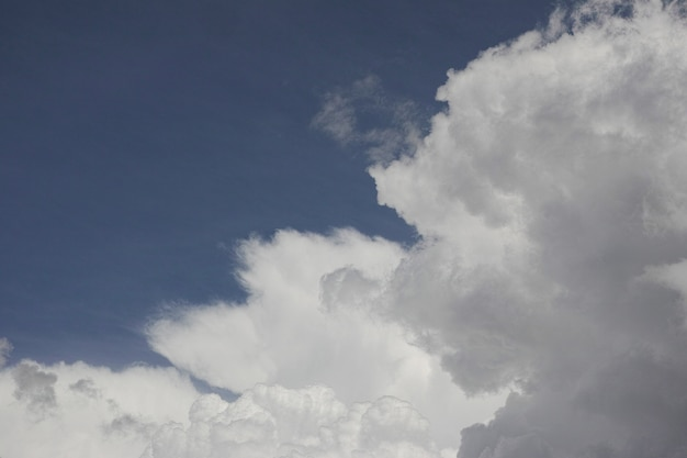 White clouds with blue sky behind