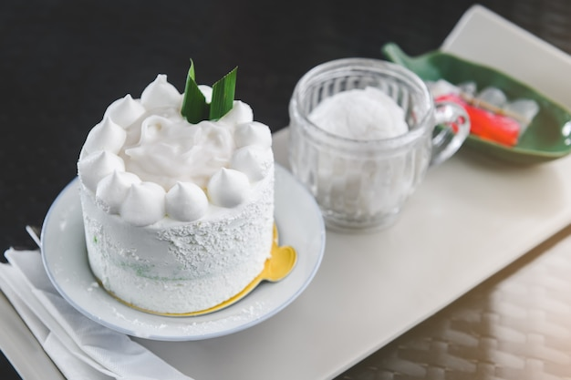 White coconut cake set with indoor lighting
