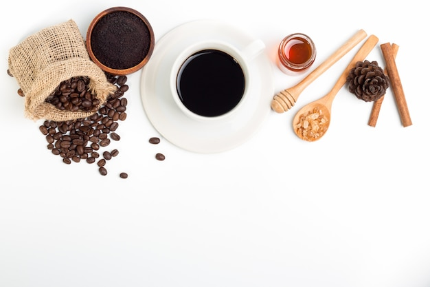 White coffee cup and coffee beans honey sugar on wood spoon
