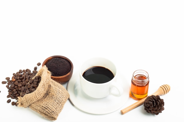 White coffee cup and coffee beans honey on white background