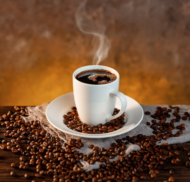 White coffee cup and coffee beans