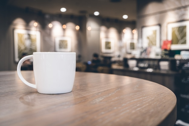 White coffee cup in coffee shop cafe