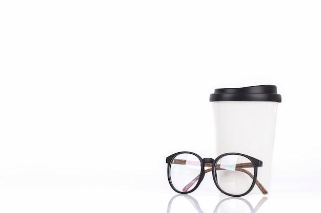 White coffee cup and glasses isolated