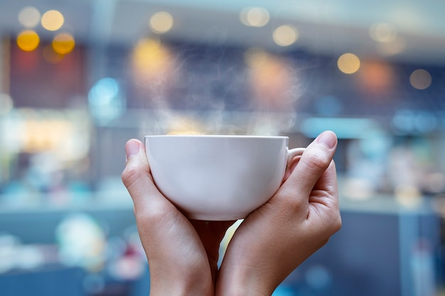 White coffee cup in hand