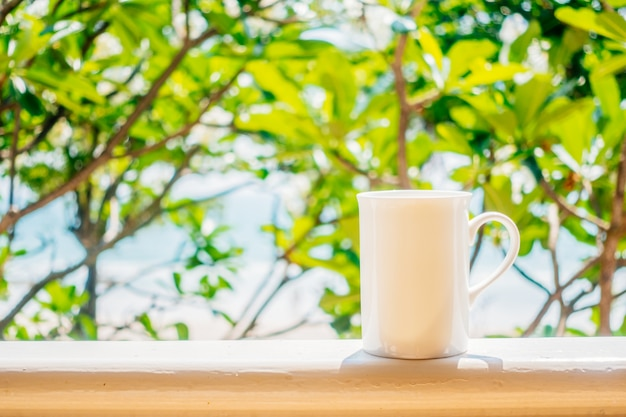 White coffee cup with outdoor view