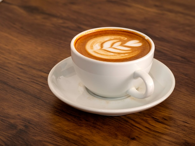 White coffee cup on wood table, coffee time