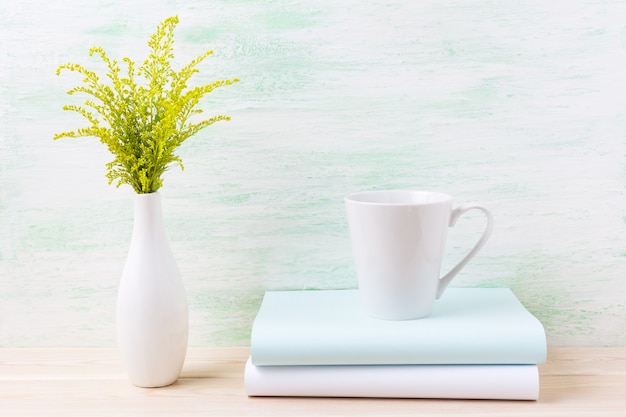 White coffee latte mug mockup with ornamental green grass